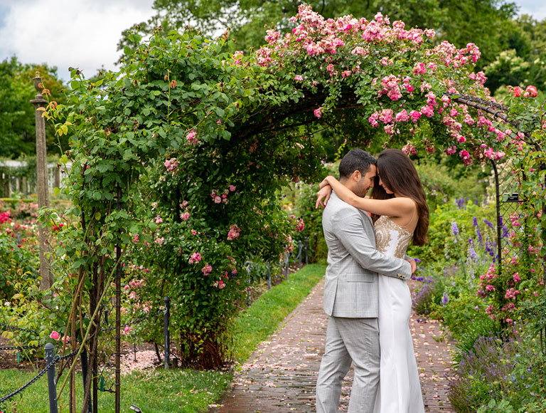 A married couple embraces at their wedding at Brooklyn Botanic Garden