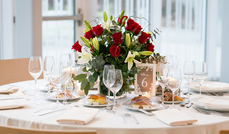 A dining table is set for an event at Brooklyn Botanic Garden