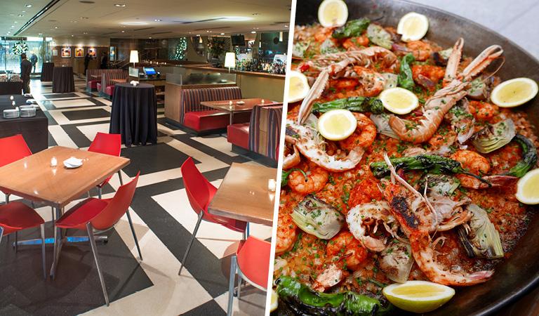 Main dining room event space inside La Fonda del Sol in NYC and paella