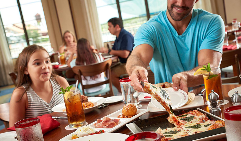 Family sharing pizza | Group Dining Venues, Orlando Florida