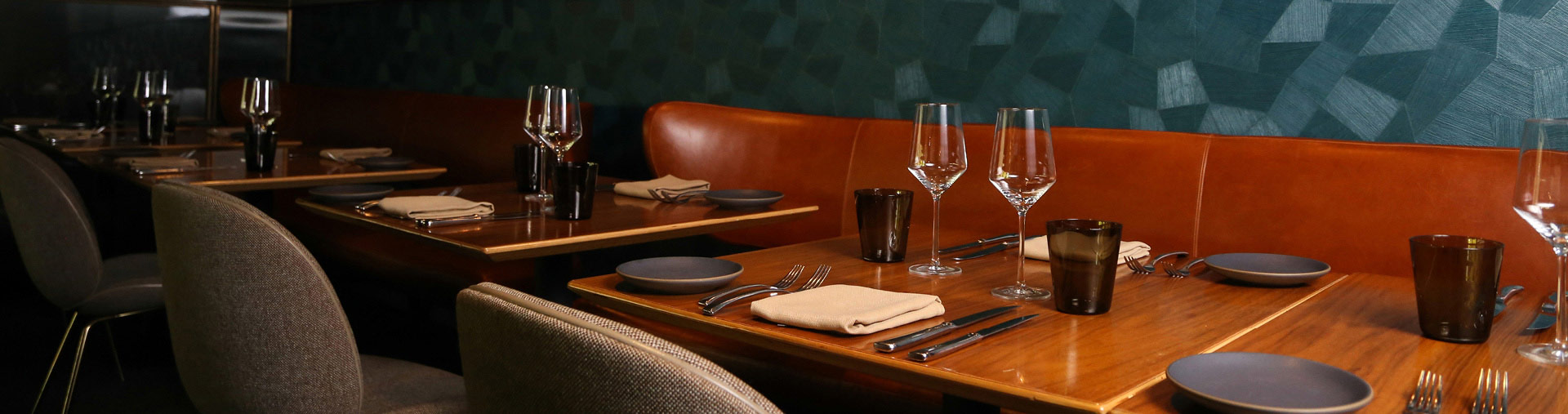 Dining table set for an event at Nick + Stef's Steakhouse in Los Angeles