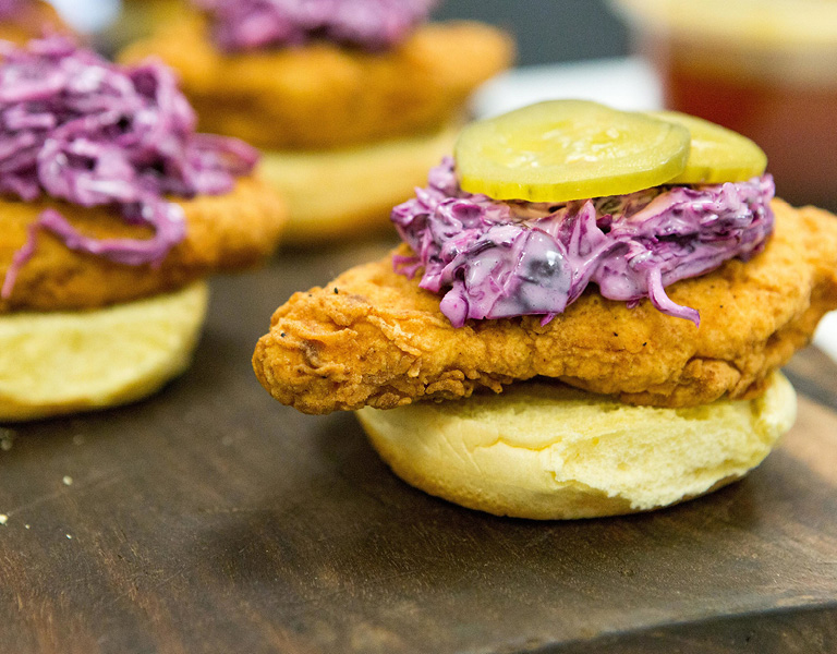 Fried chicken sandwich with red cabbage slaw and pickle