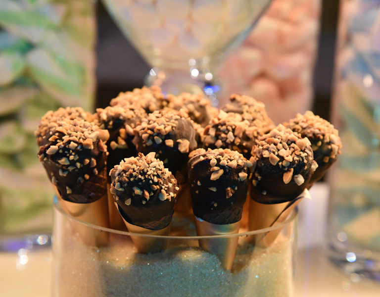 Ice cream cones with chocolate fudge and peanuts