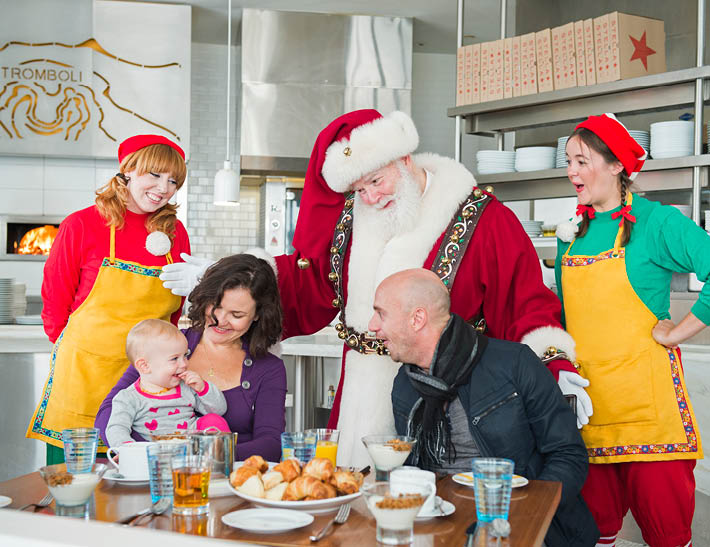 Santa and elves greet family with baby