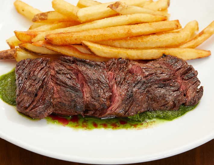 Steak entrée with fries served at STATE grill and bar in NYC