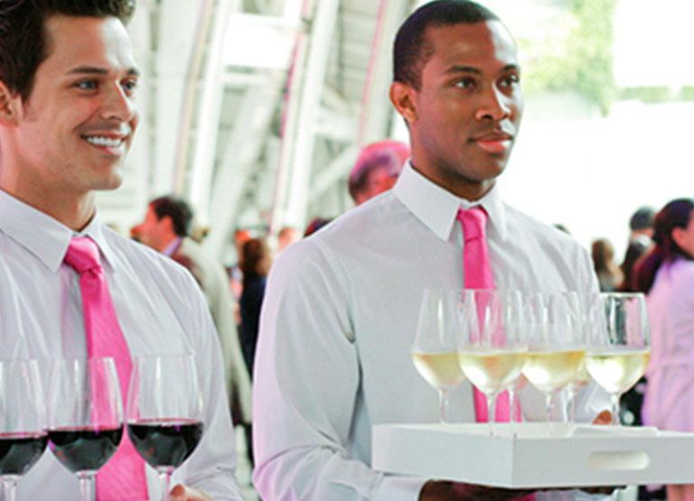 Waiters with wine